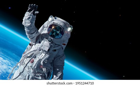 12 April 1969, International day of human space flight, Cosmonautics Day concept with ISS astronaut in spacesuit against background of the Earth planet. Spaceman in outer space 3D science illustration