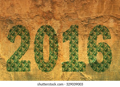 2016 typed in a pattern of clover leafs against a nature textured background. The illustration can be used for different concepts, like holidays of new years eve, st patricks day or other events.