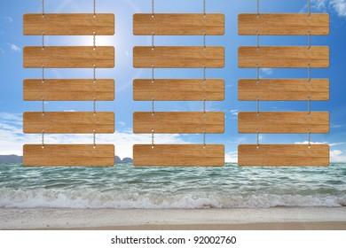 3  wood menu sign on beach