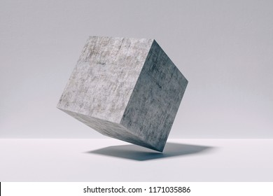 3d concrete cube against concrete wall