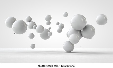 3D illustration of balls of different sizes hanging in space. The idea of order, chaos and harmony. Abstraction. Comparative image of the geometry of space. 3D rendering isolated on white background.