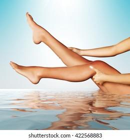 3d illustration of beautiful female legs in water
