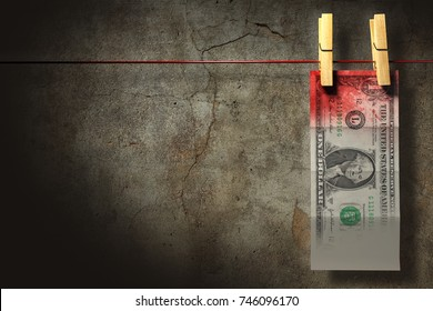 3D illustration. A blood stained dollar bill hanging to dry. Money laundry concept.