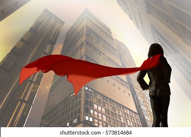 3D Illustration of business woman dressed in a suit with a Cape superhero on a background the sky on the background of skyscrapers of the city