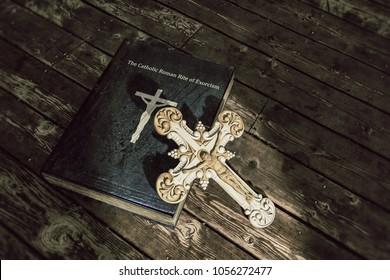 3d illustration of exorcism book on wooden floor
