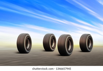 3d illustration of four black automobile wheels rush on the road with high speed