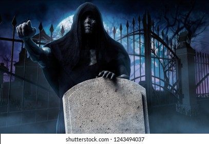 3d illustration of a grim reaper ghost in black hood pointing finger and holding tombstone on cemetery gates and full moon background.