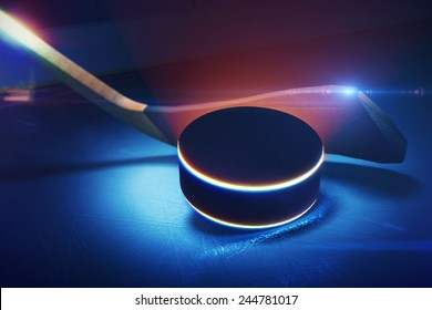 3d illustration of Hockey Stick and Puck on the Ice Rink with Shallow Depth of Field