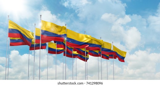 3d Illustration of many flags of Colombia in rows waving in the wind against blue sky