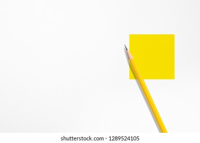 3D illustration : Minimalist presentation template with copy space by top view closeup photo of tilt yellow pencil isolated on yellow square shape in right of white paper. Studio lighting on pencil.
