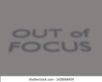 3D illustration of OUT of FOCUS blurred script over a gray background