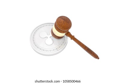 3D illustration of Ripple Coin with Judge's Gavel (Hammer) lying on top. Cryptocurrency legal law regulations concept.