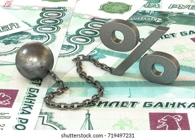 3d illustration: rust iron ball and chain with the cuff hanging percent symbol on roubles banknotes background.  The business concept of debt with a high interest rate. The stress of mortgage.