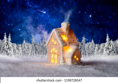 3D illustration of small lighted house with winter landscape and starry sky in the background