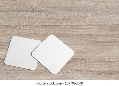 3D illustration. Square Coaster Mockup isolated on wooden background.