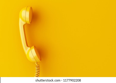 3d illustration. Vintage phone reciever on yellow background.