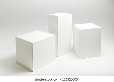 3D illustration of white cubes and parallelepipeds on cyclorama in modern photo studio