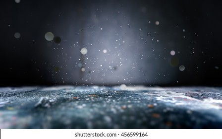 3D illustration.Abstract empty floor background in the dark.Lights defocused.Close up scenery cement floor background and shimmering glitter