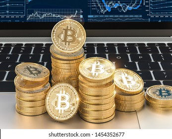3d image render of gold bitcoin coins on modern laptop. Blockchain and cryptocurrency concept.