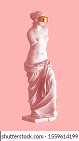 3D Model Aphrodite With Golden VR Glasses On Pink Background. Concept Of Art And Virtual Reality. 3D Illustration.