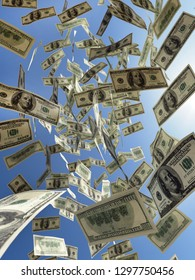 3D render of bunch of American 100 dollar bills falling down from the sky