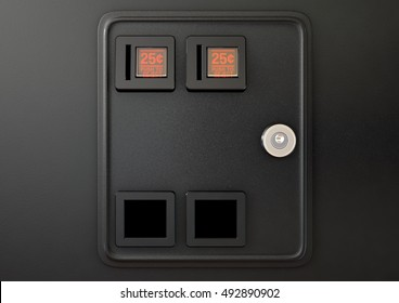 A 3D render of a closeup of a coin slot panel from a vintage arcade game machine with entry and exit slots and perspex button on an isolated background