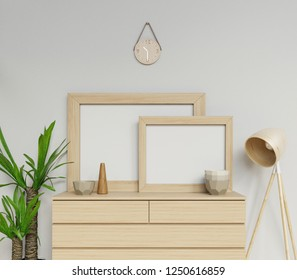 3d render of scandinavian house interior two a1 and a2 size empty poster mock up with wooden frame sitting horizontally on modern drawer perfect for portfolio in front camera view