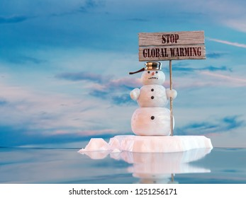 3D render of snowman holding wooden transparent with Stop Global Warming phrase floating on ice floe