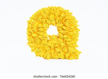 3d render yellow furry capital letter Q on a white background.