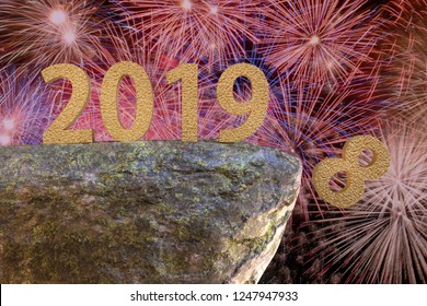 3D rendered of golden 2019 New Year date standing on the verge of rock with digit eight falling down - shot against fireworks in the night sky