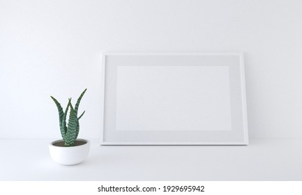 A 3D rendering of a blank frame mockup next to a potted plant leaning against a white wall