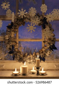 3d rendering  of candle lights and frozen window with a Christmas wreath. Christmas background.