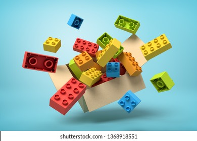 3d rendering of cardboard box in air full of colorful toy bricks which are flying out and floating outside on blue background. Children's goods. Toys and games. Toy manufacture.