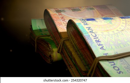 A 3D rendering of a close-up view of three wads of folded over stacks of south african banknotes each bound informally by a rubber band on an isolated studio background