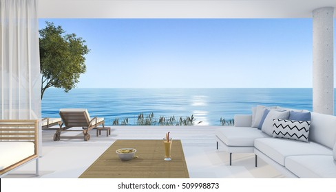 3d rendering contemporary nice living room near beach and blue sky