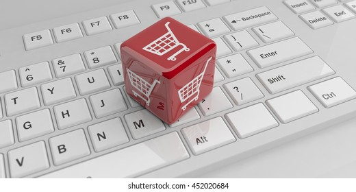 3d rendering cube with e-commerce symbol on a white keyboard