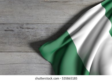 3d rendering of Federal Republic of Nigeria flag waving on wooden background