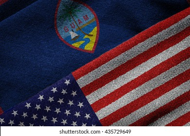 3D rendering of the flags of USA and Guam on woven fabric texture. Guam is a U.S. territory. Detailed textile pattern and grunge theme.