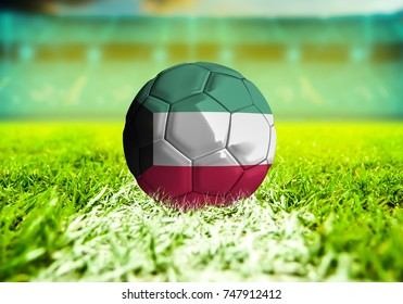 3D rendering football ball with the national flag of Kuwait ball with Green grass background