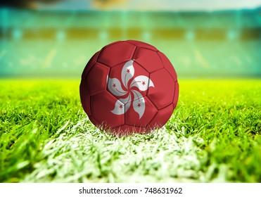 3D rendering football ball with the national flag of Hong Kong ball with Green grass background