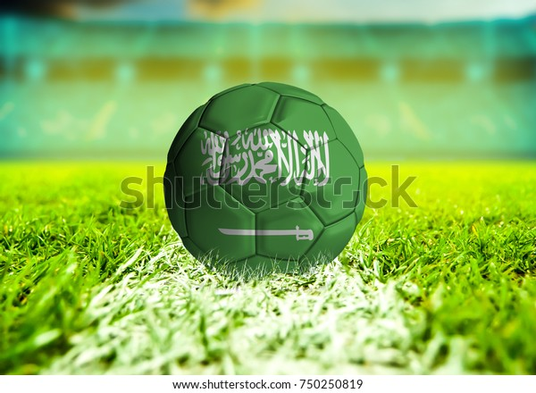 3D rendering football ball with the national flag of Saudi Arabia ball with Green grass background