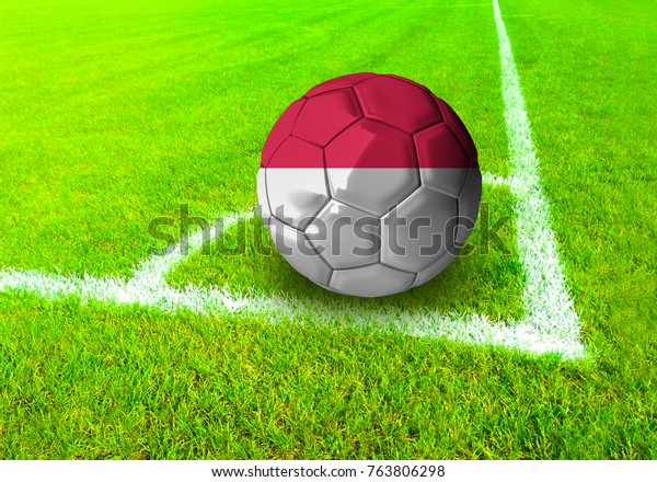3D rendering football ball with the national flag of Indonesia ball with Green grass background