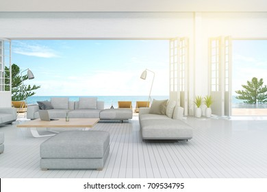 3d rendering : illustration of interior living room and swimming pool in house or resort. Beach living with Sea view. white modern interior furnish decoration style. soft light color picture style