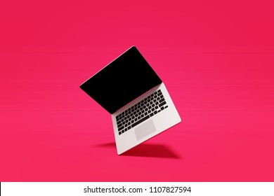 3D Rendering : Illustration of laptop notebook mock up with color background. float or levitate laptop. technology gadget for hipster background concept. high resolution