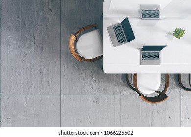 3D Rendering : illustration of modern interior Creative designer office desktop with PC computer. mock up working place. light from outside. loft cement wall background. from top view