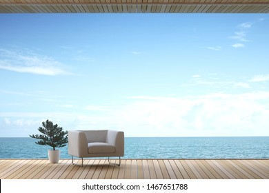 3D Rendering : illustration of soft couch armchair in wide window glass view living room interior. sea view living room. modern cosy wooden tile building room. rest area of family.