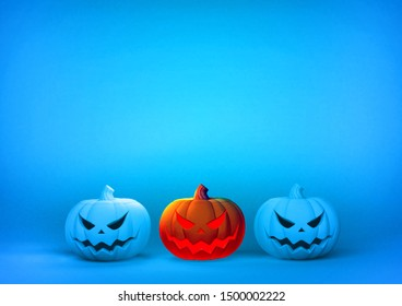 3D rendering illustration three of Jack o lantern the pumpkin with evil face glowing on blue blank space template background  for Halloween event