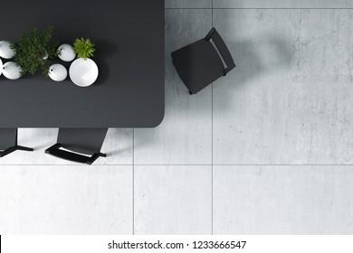 Representación 3D: ilustración de la vista superior de la mesa de la cena en el piso de cemento del loft en el comedor. mesa y silla de madera negra. pequeña decoración vegetal en la mesa. comedor minimalista.