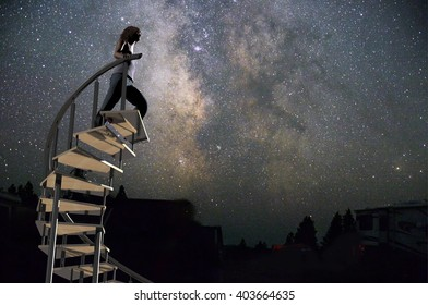 3d rendering illustration of a woman climbing a stairway with a photo I took of the milkyway in the background
