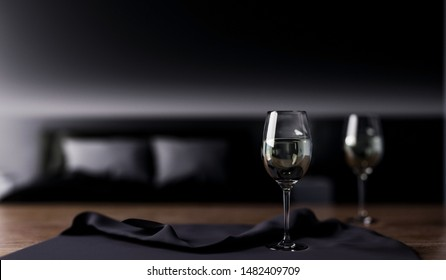 3d rendering interior, glass of wine foreground and black bedroom background.
